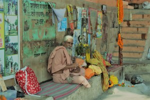 Indian man on the banks of Ganges River in Varanasi
